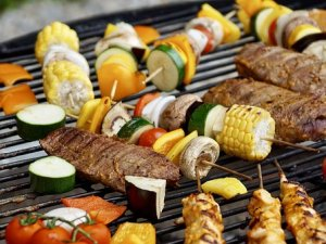 grilling corn and zucchini and steak